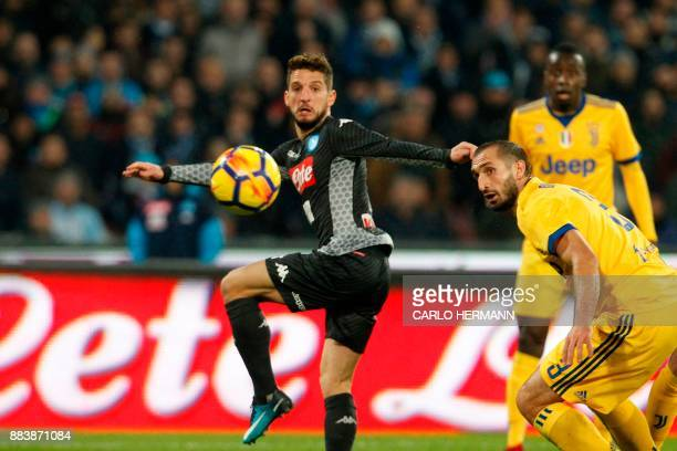 Juventus' defender from Italy Giorgio Chiellini vies with Napoli's forward from Belgium Dries Mertens during the Italian Serie A football match...