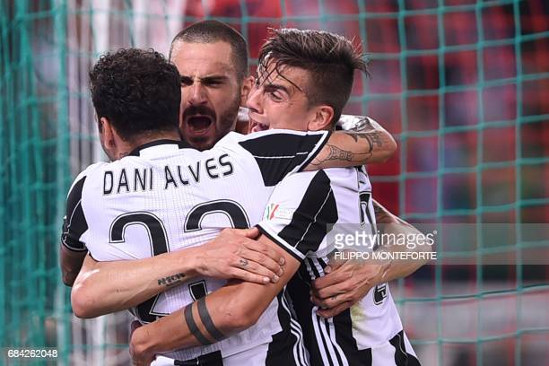 TOPSHOT Juventus' defender from Italy Leonardo Bonucci celebrates with teammates Juventus' forward from Argentina Paulo Dybala and Juventus Defender...