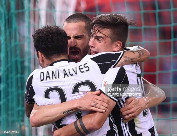 Juventus' defender from Italy Leonardo Bonucci celebrates with teammates Juventus Defender from Brazil Dani Alves and Juventus' forward from...