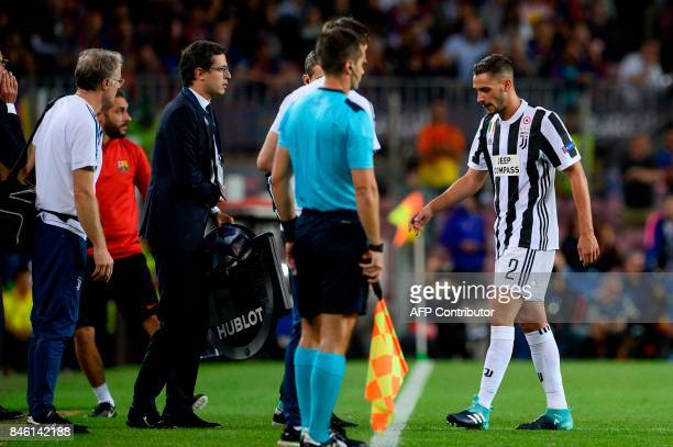 Juventus' defender from Italy Mattia de Sciglio leaves the pitch due to an injury during the UEFA Champions League Group D football match FC...