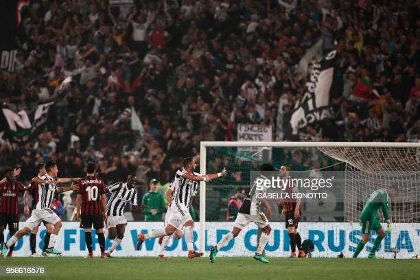 Juventus' defender from Italy Medhi Benatia celebrates after scoring during the Italian Tim Cup final Juventus vs AC Milan at the Olympic stadium on...