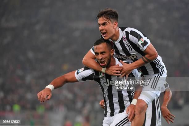 Juventus' defender from Italy Medhi Benatia celebrates with Juventus' forward from Argentina Paulo Dybala after scoring during the Italian Tim Cup...