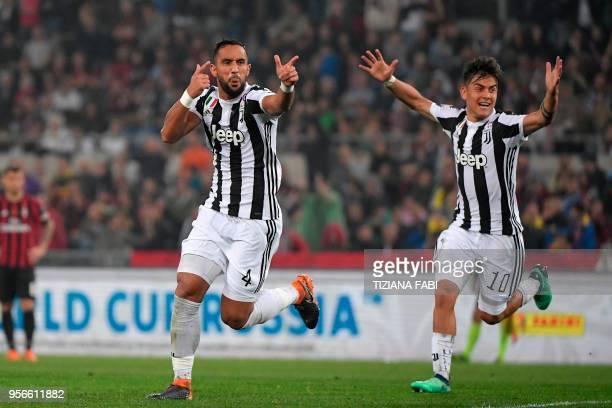 Juventus' defender from Italy Medhi Benatia celebrates with teammate Juventus' forward from Argentina Paulo Dybala after scoring during the Italian...