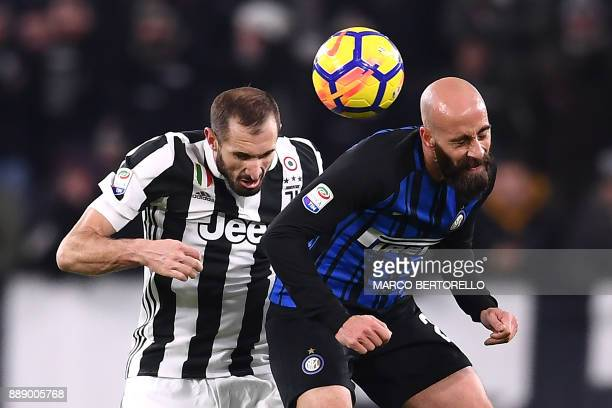 TOPSHOT Juventus' defender Giorgio Chiellini and Inter Milan's midfielder Borja Valero from Spain go for a header during the Italian Serie A football...