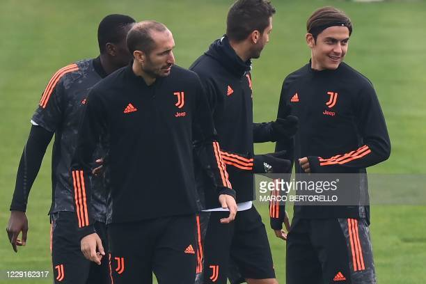 Juventus defender Giorgio Chiellini and Juventus forward Paulo Dybala from Argentina attend the training session at the Juventus Training Center in...