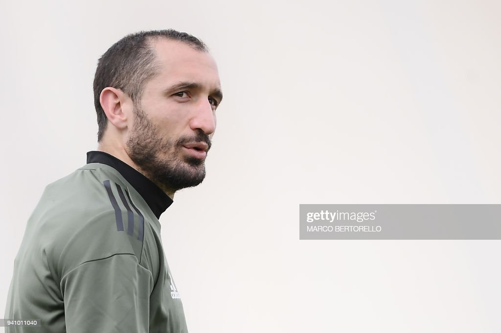 Juventus' defender Giorgio Chiellini attends a training session on the eve of the UEFA Champions League football match Juventus vs Real Madrid on April 2, 2018 at the Juventus training center in Vinovo. /