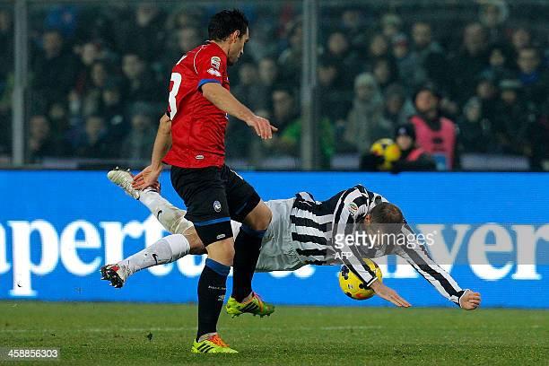 Juventus' defender Giorgio Chiellini fights for the ball with Atalanta's Davide Brivio during the Italian Serie A football match Atalanta vs Juventus...