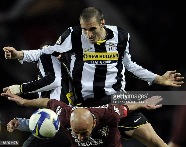 Juventus defender Giorgio Chiellini fights for the ball with Torino's foward Roberto Stellone during their city derby Serie A football match against...