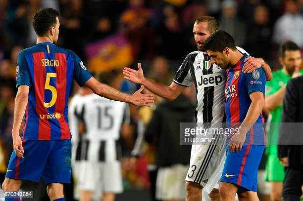 Juventus' defender Giorgio Chiellini shakes hands with Barcelona's midfielder Sergio Busquets and Barcelona's Uruguayan forward Luis Suarez after the...