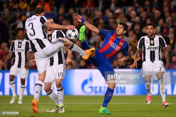 Juventus' defender Giorgio Chiellini vies with Barcelona's Uruguayan forward Luis Suarez during the UEFA Champions League quarterfinal second leg...