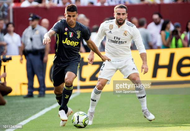 Juventus defender Joao Pedro Cavaco Cancelo moves away from Real Madrid defender Daniel Carvajal during an International Champions Cup match between...