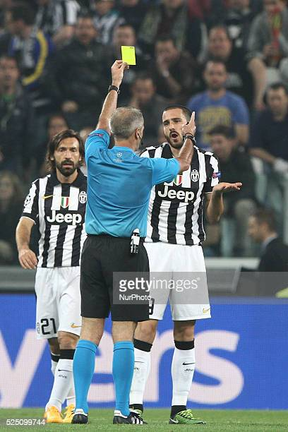 Juventus defender Leonardo Bonucci is shown a yellow card by the referee MartinAtkinson during the Uefa Champions League semi finals football match...