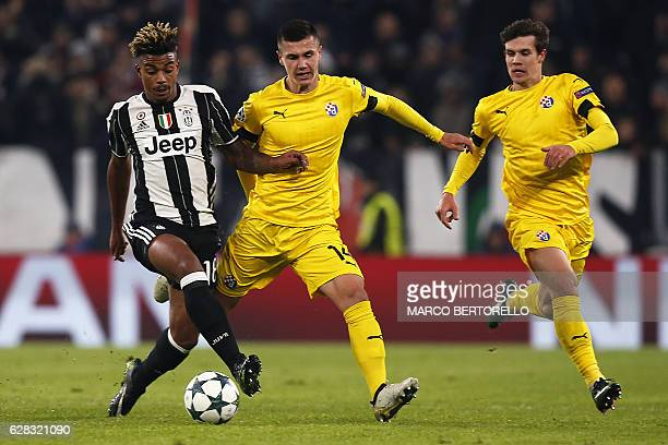 Juventus' defender Mario Lemina from France fights for the ball with Dinamo's forward Amer Gojak of Bosnia Erzegovina during the UEFA Champions...