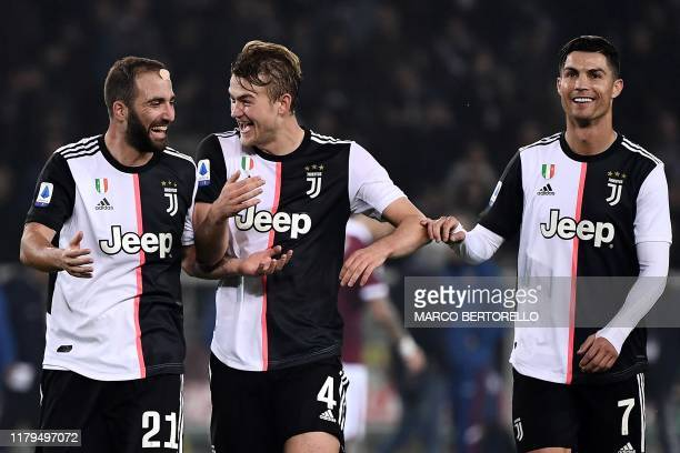 Juventus' defender Matthijs de Ligt from Netherland celebrates with Juventus' Portuguese forward Cristiano Ronaldo and Juventus' forward Gonzalo...