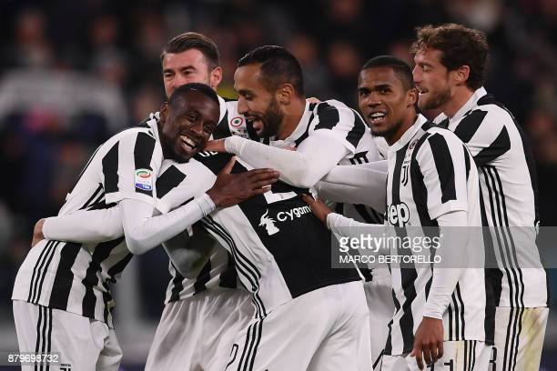Juventus' defender Mattia De Sciglio celebrates with teammates after scoring during the Italian Serie A football match Juventus Vs Crotone on...