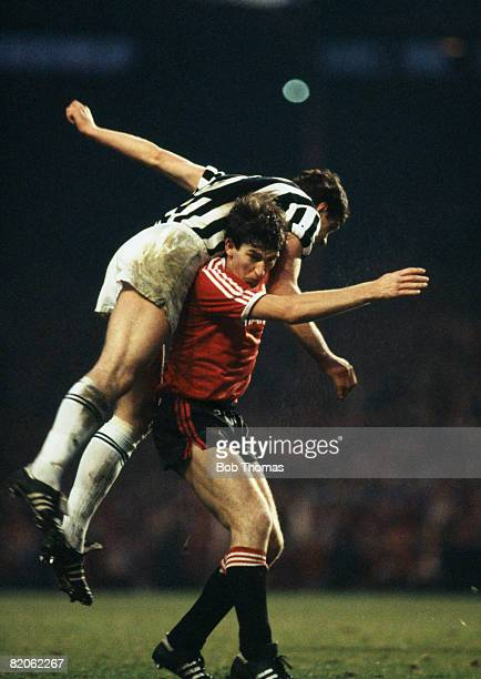 Juventus defender Sergio Brio leans on Manchester United's Norman Whiteside during their European Cup Winners Cup Semi-Final 1st leg at Old Trafford,...
