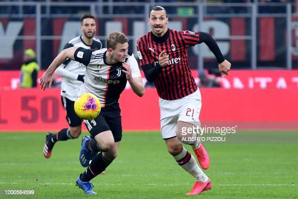 Juventus' Dutch defender Matthijs de Ligt and AC Milan's Swedish forward Zlatan Ibrahimovic go for the ball during the Italian Cup semifinal first...