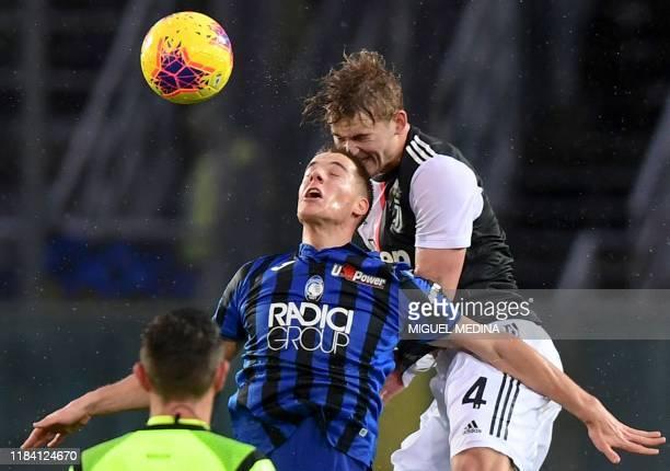 Juventus' Dutch defender Matthijs de Ligt and Atalanta's Croatian midfielder Mario Pasalic go for a header during the Italian Serie A football match...