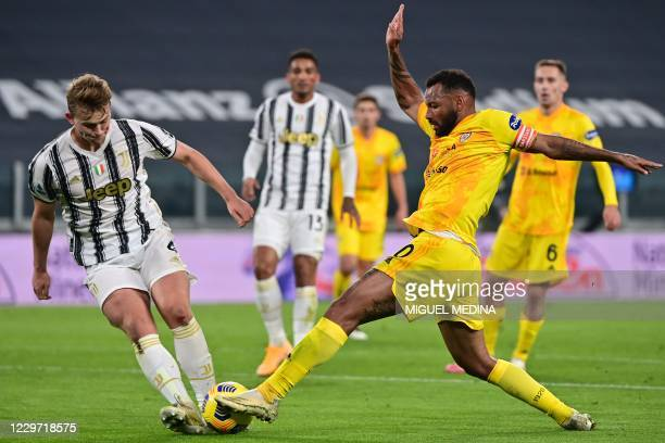 Juventus' Dutch defender Matthijs De Ligt and Cagliari's Brazilian midfielder Joao Pedro go for the ball during the Italian Serie A football match...