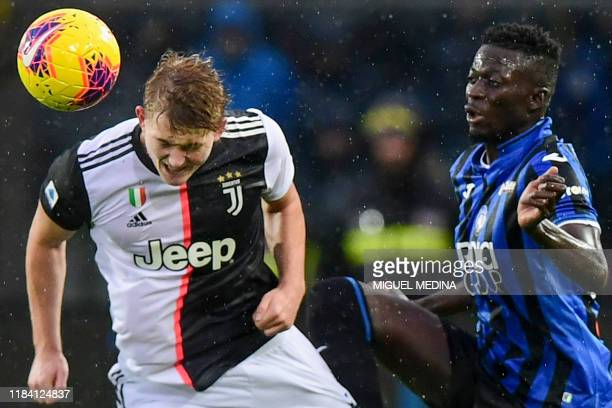 Juventus' Dutch defender Matthijs de Ligt defends against Atalanta's Gambian forward Musa Barrow during the Italian Serie A football match Atalanta...