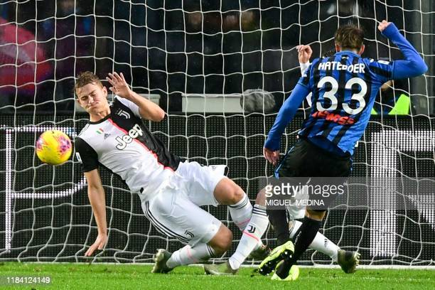 Juventus' Dutch defender Matthijs de Ligt saves a ball on the goal line during the Italian Serie A football match Atalanta Bergamo vs Juventus on...