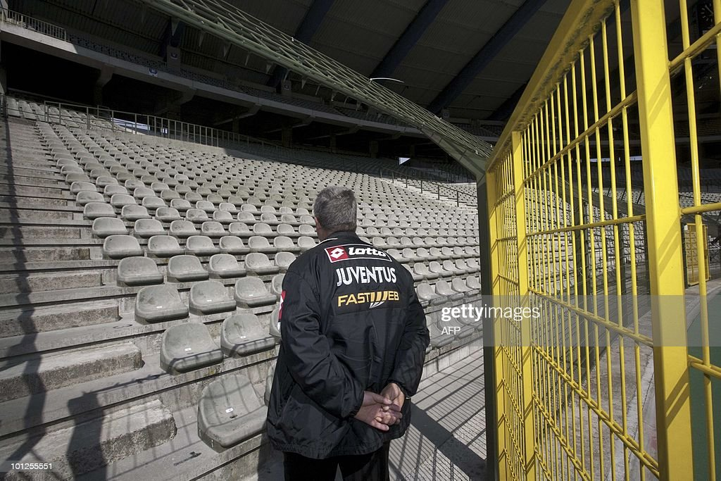 A Juventus fan looks at a stand on the 2
