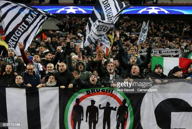 Juventus fans celebrate during the UEFA Champions League Round of 16 Second Leg match between Tottenham Hotspur and Juventus at Wembley Stadium on...