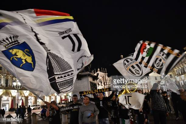 Juventus fans celebrate in downtown Turin after Juventus secured its 8th consecutive Italian 2018/19 Scudetto Serie A championships after winning the...