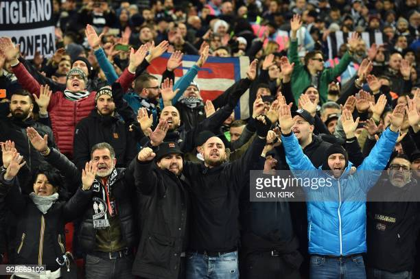 Juventus fans chant in the crowd as they wait for kick off in the UEFA Champions League round of sixteen second leg football match between Tottenham...