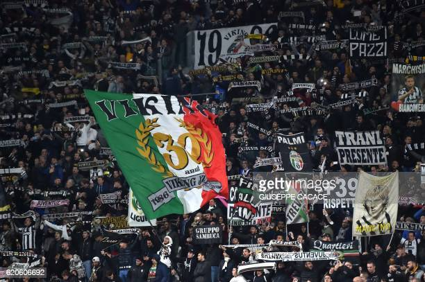 Juventus fans cheer before the UEFA Champions League football match Juventus vs Olympique Lyonnais on November 2 2016 at the Juventus stadium in...