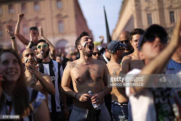 Juventus fans cheer for their team as they gather in Piazza San Carlo in Turin to watch the UEFA Champions League final football match between...