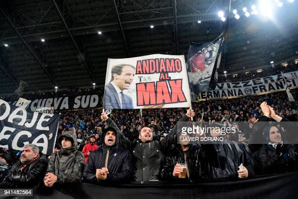 Juventus fans cheer for their team with a picture of Juventus' Italian coach Massimiliano Allegri before the UEFA Champions League quarterfinal first...