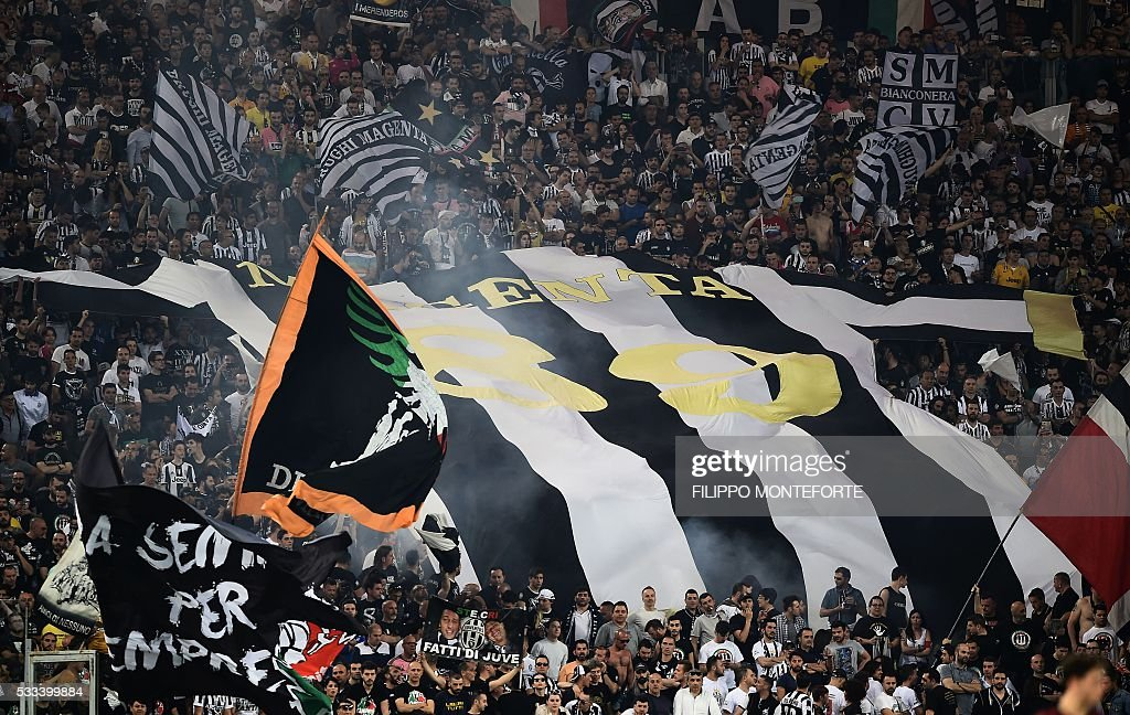Juventus fans deploy a giant jersey in the stands during the Italian Tim Cup final football match AC Milan vs Juventus on May 21, 2016 at the Olympic Stadium in Rome.