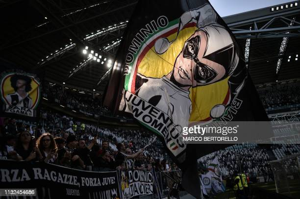 Juventus fans display a giant tifo prior to the Women's Serie A football match Juventus vs Fiorentina on March 24 2019 at the Juventus stadium in...