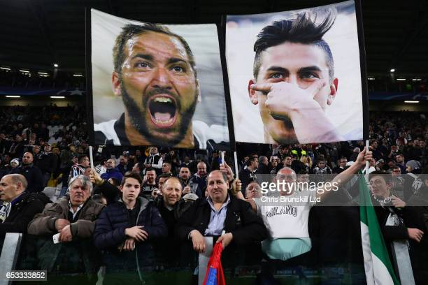 Juventus fans hold up Gonzalo Higuain and Paulo Dybala banners prior to the UEFA Champions League Round of 16 second leg match between Juventus and...