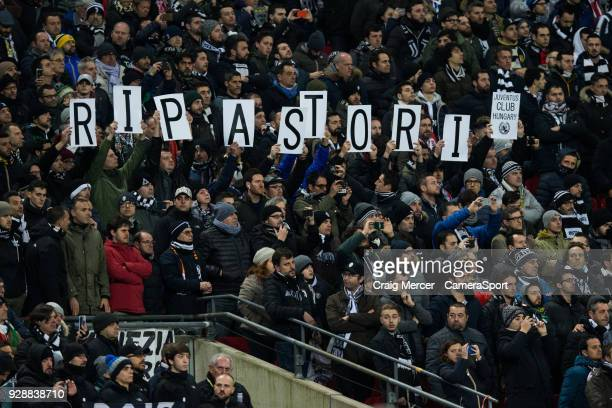 Juventus fans hold up letters spelling RIP Astori in tribute to Davide Astori who passed away recently during the UEFA Champions League Round of 16...
