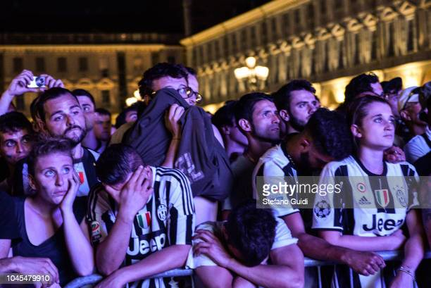 Juventus Fans watch the match and cheer before the first wave of panic during the Champions League final between Real Madrid and Juventus on the...