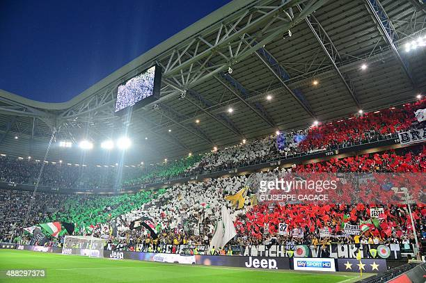 Juventus' fans wave their flags during the Italian seria A football match Juventus vs Atalanta on May 05 in Alps stadium the 'Juventus Stadium' in...