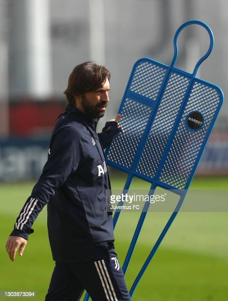 Juventus FC coach Andrea Pirlo looks on during a Juventus training session at JTC on February 24, 2021 in Turin, Italy.