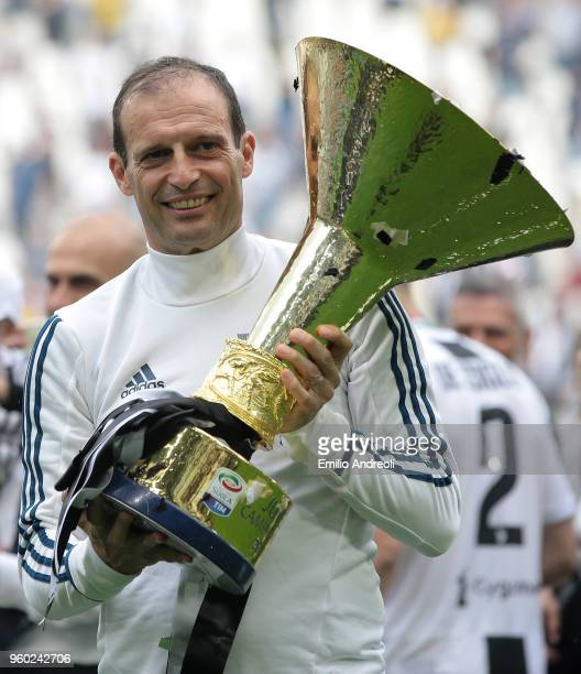 Juventus FC coach Massimiliano Allegri celebrates with the trophy after winning the Serie A Championship at the end of the serie A match between...