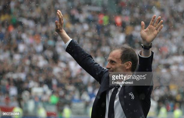 Juventus FC coach Massimiliano Allegri greets the fans during the serie A match between Juventus and Hellas Verona FC at Allianz Stadium on May 19...