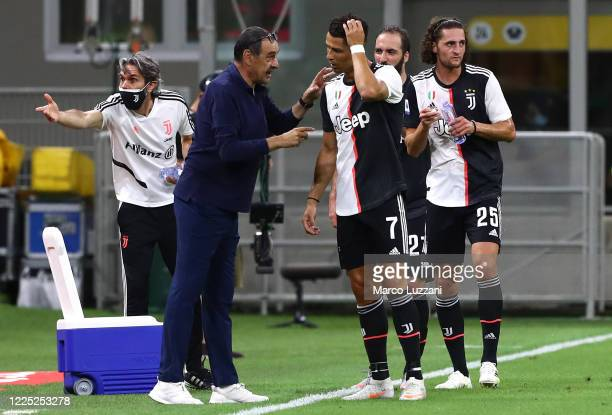 Juventus FC coach Maurizio Sarri issues instructions to his player Cristiano Ronaldo during the Serie A match between AC Milan and Juventus at Stadio...