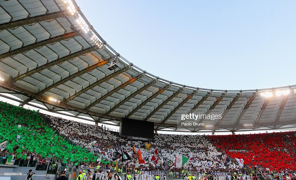 Juventus FC fans support their team during the TIM Cup final match between AC Milan and Juventus FC at Stadio Olimpico on May 21, 2016 in Rome, Italy.