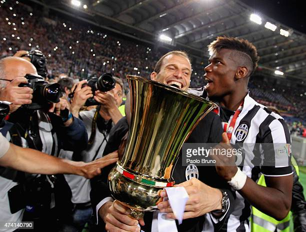 Juventus FC head coach Massimiliano Allegri and Paul Pogba celebrate with the trophy after winning the TIM Cup final match against SS Lazio at...