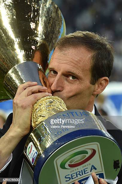 Juventus FC head coach Massimiliano Allegri celebrates with the Serie A Trophy at the end of the Serie A match between Juventus FC and SSC Napoli at...