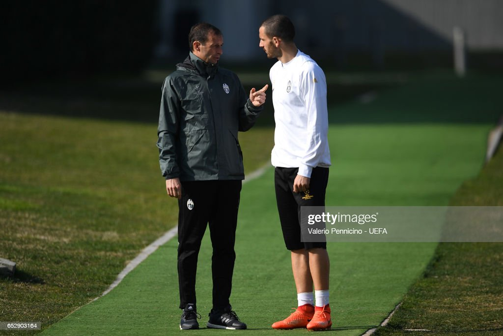 Juventus FC head coach Massimiliano Allegri (L) talks with Leonardo Bonucci during a training session ahead of the UEFA Champions League Round of 16 second leg match between Juventus and FC Porto at Juventus Training Center ground on March 13, 2017 in Turin, Italy.