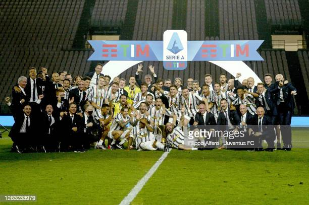 Juventus FC players and staff celebrate the winning of the Italian championship scudetto 20192020 with the trophy after the Serie A match between...
