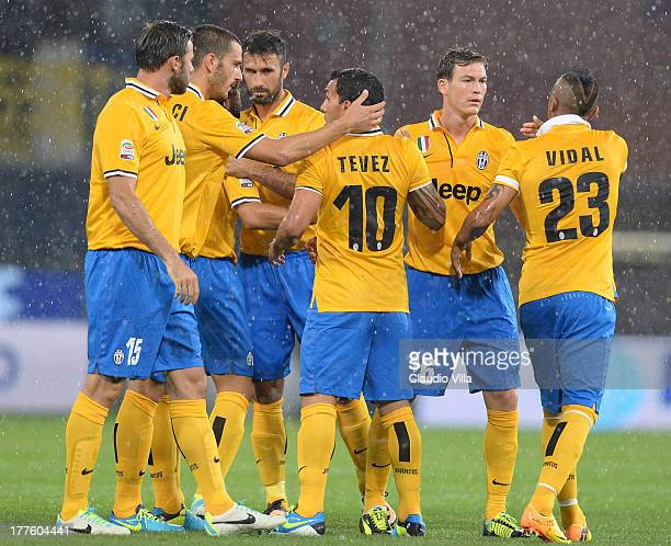 Juventus FC players celebrate during the Serie A match between UC Sampdoria and Juventus at Stadio Luigi Ferraris on August 24 2013 in Genoa Italy