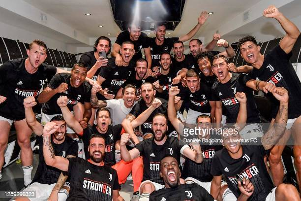 "Juventus FC players celebrate in the dressing room after the winning of the Italian championship ""scudetto"" 2019-2020 after the Serie A match between..."