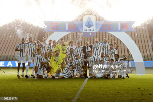 Juventus FC players celebrate the winning of the Italian championship scudetto 20192020 with the trophy after the Serie A match between Juventus and...